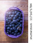 basket full of delicious plums  ... | Shutterstock . vector #1171671784