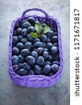 basket full of delicious plums  ... | Shutterstock . vector #1171671817