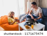 young couple at home working... | Shutterstock . vector #1171675474