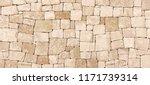 masonry wall of stones with...