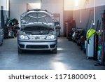 Vehicle Repair Shop With Car...