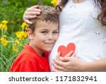 young boy and pregnant mom... | Shutterstock . vector #1171832941