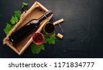 a bottle of red wine on a black ...   Shutterstock . vector #1171834777