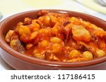 spanish callos, a stew with beef tripe, chickpeas and chorizo typical of Spain - stock photo