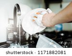 the man washes the dirty dishes ... | Shutterstock . vector #1171882081