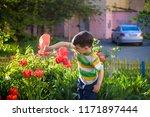 little child walking near... | Shutterstock . vector #1171897444