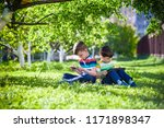 two brother kid is lying on the ... | Shutterstock . vector #1171898347