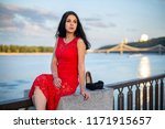 a girl in a long red dress is... | Shutterstock . vector #1171915657