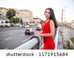 girl in a long red dress is... | Shutterstock . vector #1171915684