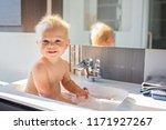 baby taking bath in sink. child ... | Shutterstock . vector #1171927267
