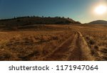 Walking On Dirt Road At Sunrise ...