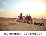 camel trek at desert safari... | Shutterstock . vector #1171956724