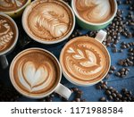 hot coffee in a cup with foam... | Shutterstock . vector #1171988584