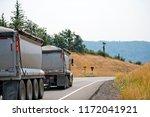a dump big rig semi truck with...   Shutterstock . vector #1172041921