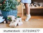 little child girl is decorating ... | Shutterstock . vector #1172104177