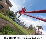 happy child on a swing enjoying ... | Shutterstock . vector #1172118277