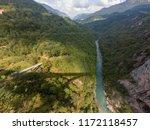 river flowing through a deep... | Shutterstock . vector #1172118457
