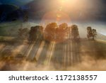 beautiful misty and foggy... | Shutterstock . vector #1172138557