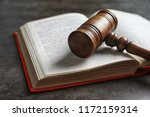 Wooden Gavel And Book On Dark...