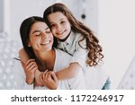 young mother and smiling little ... | Shutterstock . vector #1172246917