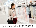 beautiful woman shopping clothes | Shutterstock . vector #1172253097