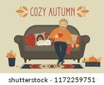 cozy autumn. man drink tea or... | Shutterstock .eps vector #1172259751