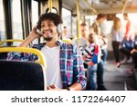 young afro american man is... | Shutterstock . vector #1172264407