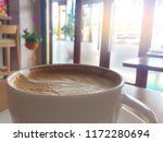 a cup of coffee is on wooden... | Shutterstock . vector #1172280694