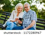 happy senior couple is using...   Shutterstock . vector #1172280967