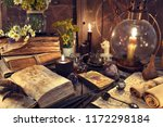 Stock photo still life with old fashioned lamp magic witch books tarot cards and old papers mystic 1172298184