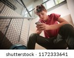 sad teenage boy with mobile...   Shutterstock . vector #1172333641