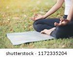 close up hands. woman do yoga... | Shutterstock . vector #1172335204