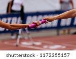 women team relay race passing... | Shutterstock . vector #1172355157