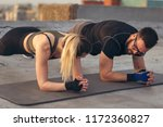 couple working out on a... | Shutterstock . vector #1172360827