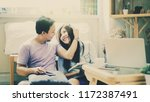 couple of asian lover sitting... | Shutterstock . vector #1172387491