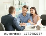 real estate agent working with... | Shutterstock . vector #1172402197