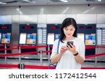girl using smartphone in front... | Shutterstock . vector #1172412544
