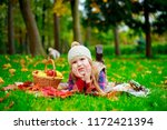 happy girl with a basket of... | Shutterstock . vector #1172421394