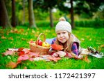 happy girl with a basket of... | Shutterstock . vector #1172421397