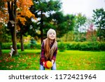 happy little girl  playing with ... | Shutterstock . vector #1172421964