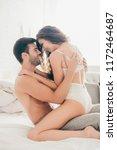happy seductive young couple... | Shutterstock . vector #1172464687