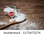 Small photo of Stop sign on the sugar, warned that the sugar too much will make unhealthy nutrition, obesity, diabetes, dental care and much more.