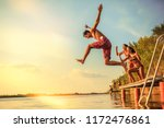 group of friends jumping into... | Shutterstock . vector #1172476861
