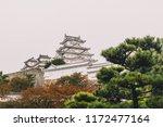 himeji castle on rainy day in... | Shutterstock . vector #1172477164