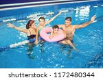 a happy family is smiling in a... | Shutterstock . vector #1172480344