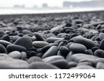 Rond Black Pebbles On The Beac...