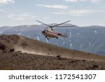 helicopter on the volcano... | Shutterstock . vector #1172541307