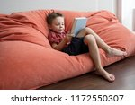 a cute preschool boy sitting... | Shutterstock . vector #1172550307