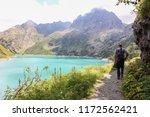 trekker in front of barbellino... | Shutterstock . vector #1172562421