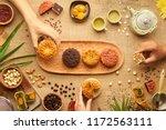 hands of people eating tasty... | Shutterstock . vector #1172563111